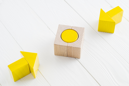 Symbol of goal and objective. Two wooden arrows converge towards the center target. Arrows pointing to the object. Business concept. The concept of the goal, the implementation of the planned success.