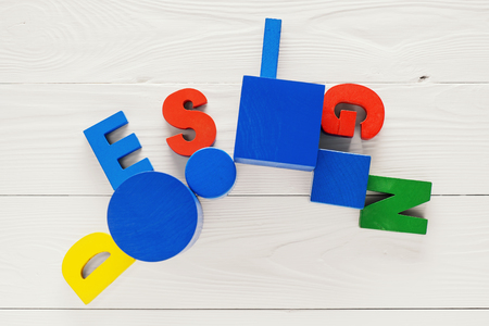 The concept of design word on colorful wooden letters. Design word letters. Letters collected in the word Design