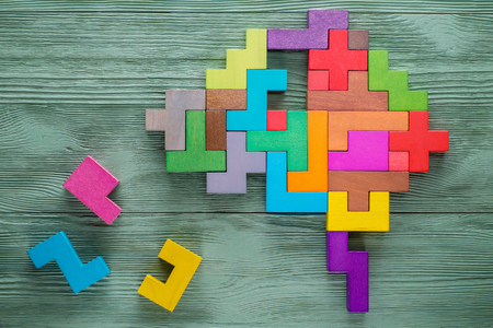 Human brain is made of multi-colored wooden blocks. Creative medical or business concept. Stock Photo