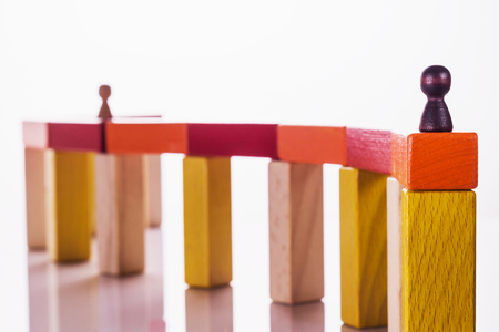 Abstract man on top of a wooden construction, the concept of a career competition, career ladder, business learning success, business hierarchy. Achieving success. Social status, business metaphor. Stock Photo