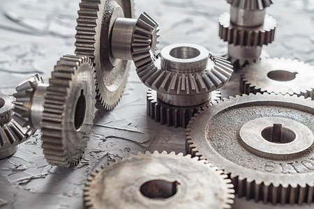Steel gear and reducer, engineering details. Metal cogwheels. Industry Concept.