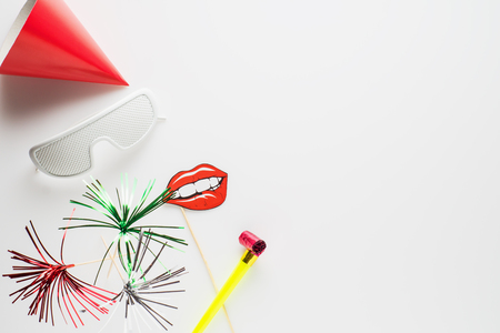 Party decoration on white background. Background for carnival, birthday, New Year or any holiday.