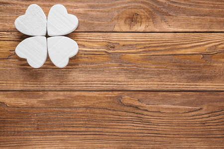 Abstract clover on wood background.  Abstract white wooden clover or butterfly.