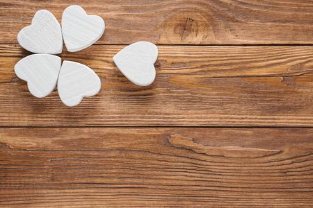 Abstract white flower on wooden background. One flower head on brown wood table background.  Standard-Bild