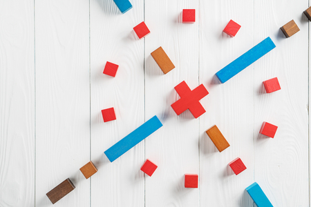 Abstract target from colourful wooden blocks. The concept of the goal, the implementation of the planned success, business. Copy space, top view, flat lay.