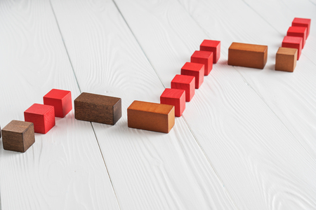 The concept of success. Business graph. Growth progress concept. Growing graph from wooden blocks.  Bar graph. Standard-Bild - 104353094