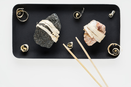 The concept of natural food. Abstract sushi made from stones and wood. Eco concept. Standard-Bild - 106354195