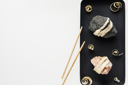 The concept of natural food. Abstract sushi made from stones and wood. Eco concept. Standard-Bild - 106354215
