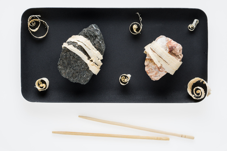 The concept of natural food. Abstract sushi made from stones and wood. Eco concept. Standard-Bild - 106354217