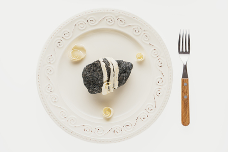 The concept of natural food. Abstract sushi made from stones and wood. Eco concept. Standard-Bild - 106385345