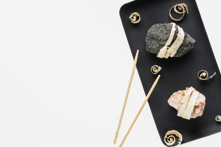 The concept of natural food. Abstract sushi made from stones and wood. Eco concept. Standard-Bild - 106385423
