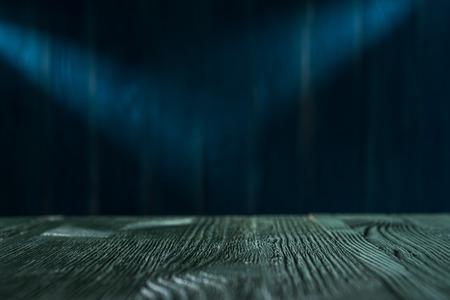 Dark blue wooden background. Magic illuminated stage in dark blue colors. Standard-Bild - 106385655