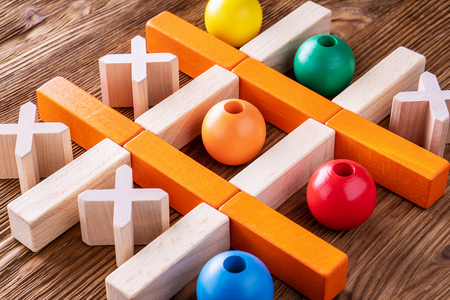 Wooden  tic tac toe (OX) game., The concept of strategy, risk, competition in business.