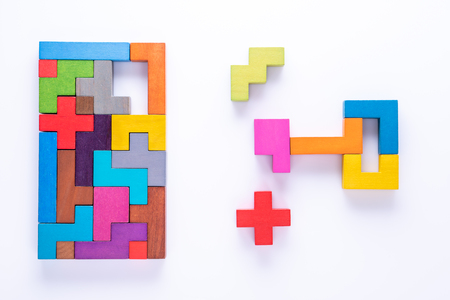 Keyhole and key, logical concept. Logical tasks composed of colorful wooden shapes, top view. Choose correct answer. 写真素材