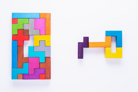 Keyhole and key, logical concept. Logical tasks composed of colorful wooden shapes, top view.