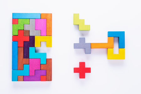 Keyhole and key, logical concept. Logical tasks composed of colorful wooden shapes, top view. Choose correct answer.