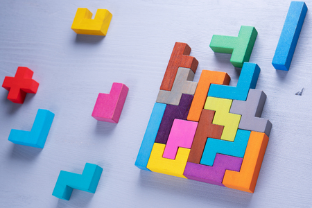 The concept of logical thinking. Geometric shapes in different colors, top view. Abstract Background. 스톡 콘텐츠