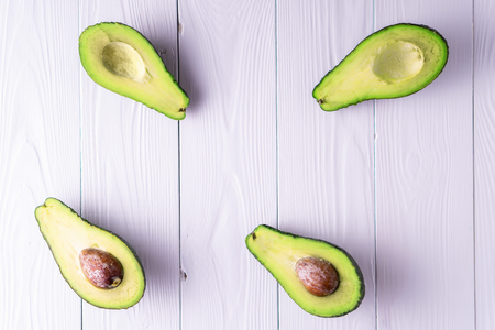 Ripe avocado, with copy space, top view, flat lay. Healthy food concept.
