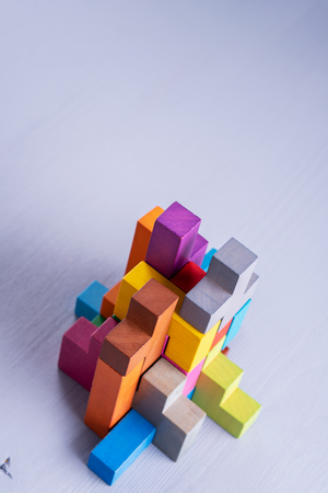 Abstract construction from wooden blocks shapes. The concept of logical thinking, geometric shapes. Stockfoto