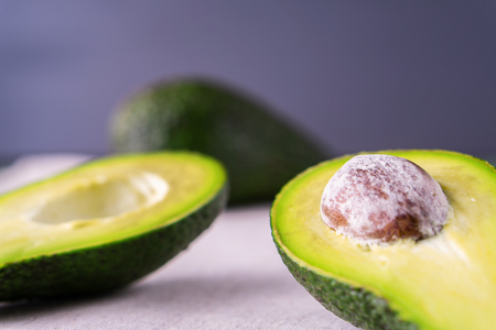 Ripe avocado. Healthy food concept.