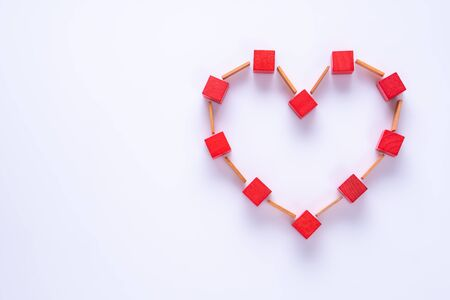 Heart made of colorful wooden shapes, top view, flat lay. Health background concept. Abstract red heart.