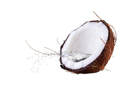 Coconut with splashes of water. Coconut isolated on the white background.