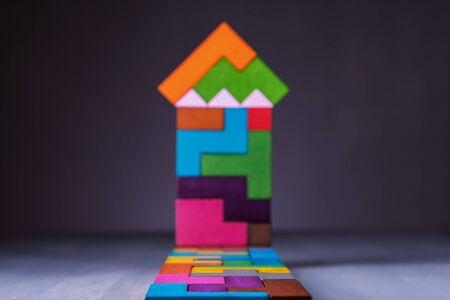 Abstract house of wooden puzzles. Business concept, sale, mortgage, rent.