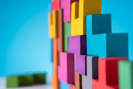 The concept of logical thinking. Geometric shapes on a blue background. Business building concept.