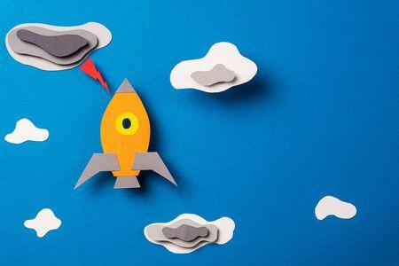 Rocket flies through the clouds. Business, start up concept. Copy space.