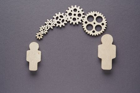 Concept of teamwork, gear system. The concept of functioning, people pieces of company mechanism. Reklamní fotografie