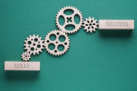 Abstract background with connected gears working together, from skills to success. Creative development process. Business concept.