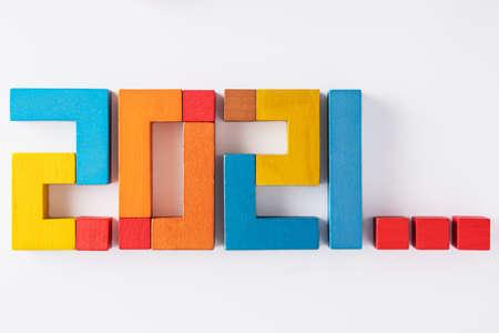 2021 from wooden colored blocks. Expectation of 2021, uncertainty of the course of events in the future. Top view. Reklamní fotografie