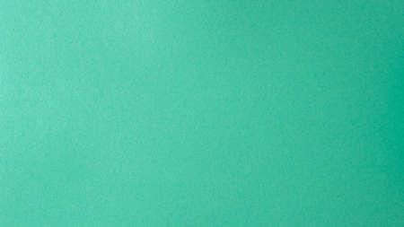 Turquoise kraft paper texture. Empty green colored paper background. Reklamní fotografie