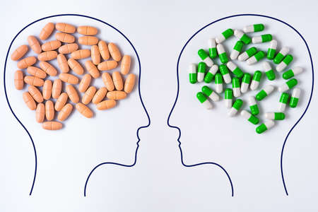 Heads of two people with nutritional supplements brain shape and pills brain shape. Two people with different thinking. Nutritional supplements versus pills. Strengthening immunity to resist viruses.