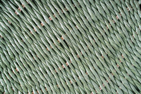 Green wicker background.