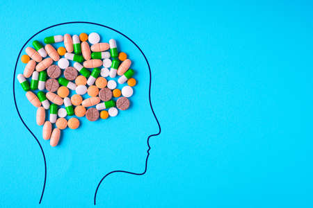 Head with nutritional supplements and pills of abstract brain.