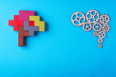 Human brain is made gear mechanism and colorful shapes on blue background. Two different thought processes. The concept of rational and irrational thinking.