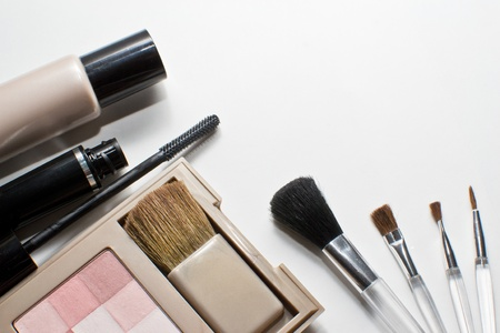 neutrals: Make-up and brushes isolated on white