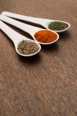 collection of various food ingredients in wooden spoons  photo