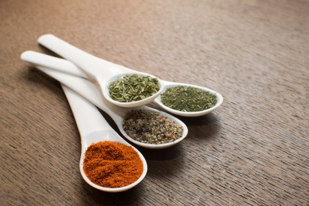 Colorful spices on the old table  photo