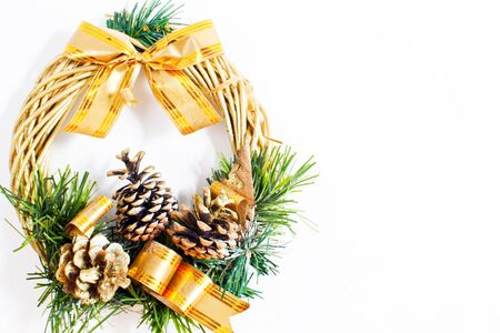 christmas wreath with golden ribbon and cones photo