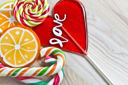 colorful lollipop on wooden background photo