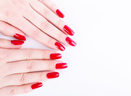 Manicure - Beautiful manicured woman s hands with red nail polish Stock Photo