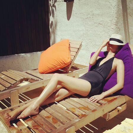 sunbeds: Model in swimsuit is sunbathing