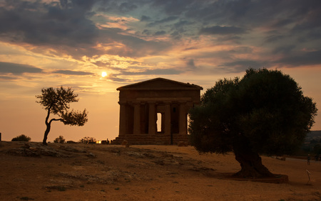 concordia: Sunset over the Temple of Concordia, Agrigento,  Sicily in Italy  Stock Photo