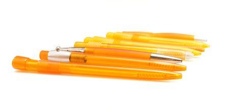 autograph: Orange pens on white ground Stock Photo