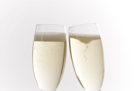 Champagne glasses on white ground