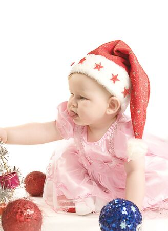 Baby in red hat on white ground Stock Photo