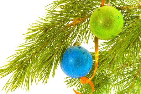 Green and blue christmas balls on fir banch photo