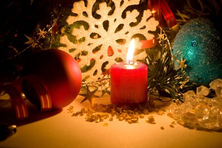Burning candle in christmas stuff photo